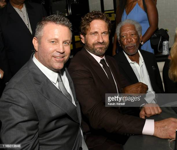 Ric Roman Waugh Gerard Butler and Morgan Freeman pose at the after party for the premiere of Lionsgate's Angel Has Fallen at STK on August 20 2019 in...