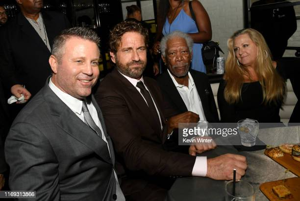 Ric Roman Waugh Gerard Butler Morgan Freeman and Lori McCreary pose at the after party for the premiere of Lionsgate's Angel Has Fallen at STK on...