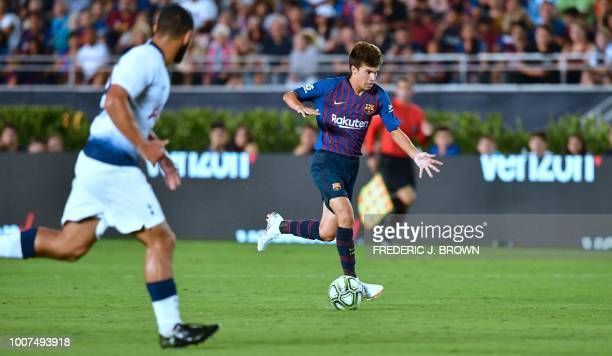 Ricard Puig of Barcelona runs with the ball as Cameron CarterVickers of Tottenham Hotspur watches during the International Champions Cup football...