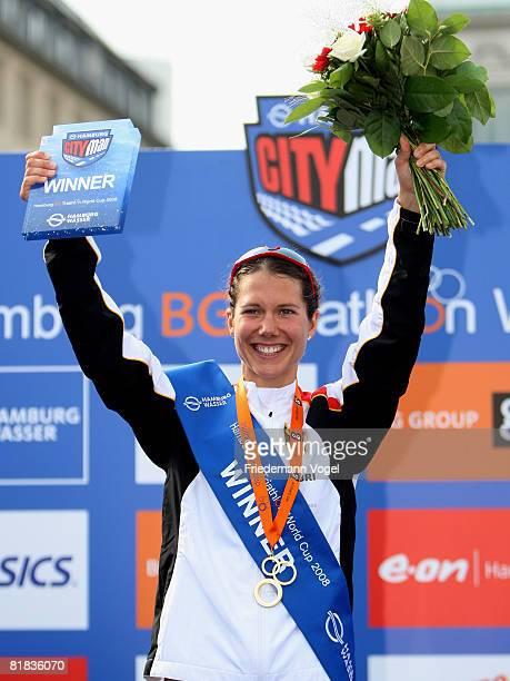Ricarda Lisk of Germany celebrates on the podium winning the Womens World Cup at the Hamburg City Man Triathlon on July 5 2008 in Hamburg Germany