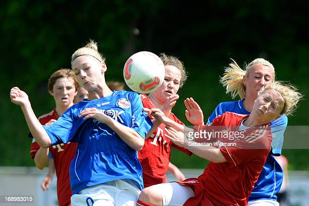 Ricarda Walkling of Muenchen challenges Lara Junge of Potsdam during the B Junior Girls match between Bayern Muenchen and Turbine Potsdam at...