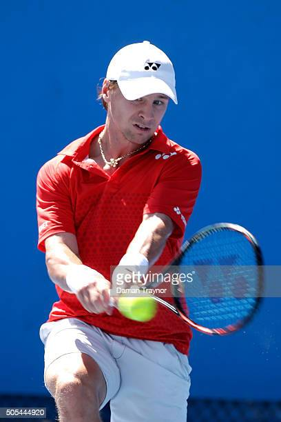 Ricardas Berankis of Lithuania plays a backhand in his first round match against Alexandr Dolgopolov of Ukraine during day one of the 2016 Australian...