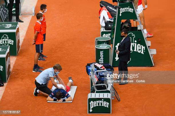 Ricardas Berankis of Lithuania receives medical treatment during his Men's Singles second round match against Novak Djokovic of Serbia on day five of...