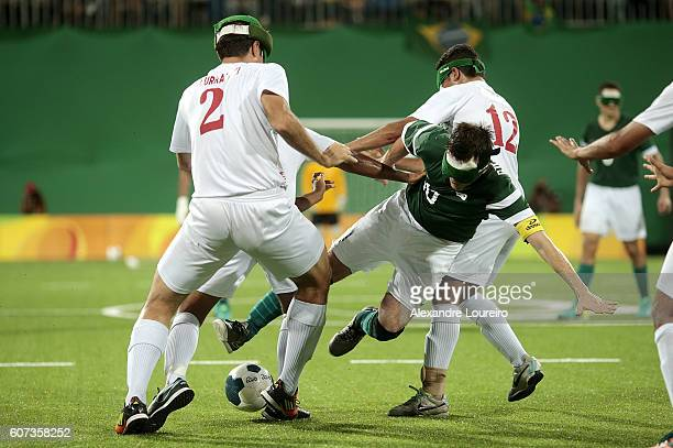 Ricardinho of Brazil fights for the ball with Amir Pourrazavi of Iran during the Football 5aside Brazil and Iran Gold Medal Match at Olympic Tennis...