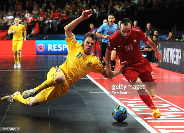 Ricardinho of Portugal and Denys Ovsyannikov of Ukraine battle for the ball during the Futsal Euro 2014 Quarter Final match between Ukraine and...