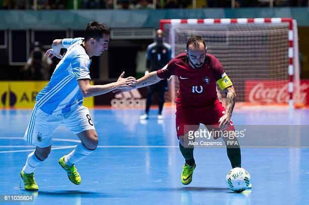 Ricardinho of Portugal conducts the ball next to Santiago Basile of Argentina during the FIFA Futsal World Cup SemiFinal match between Argentina and...