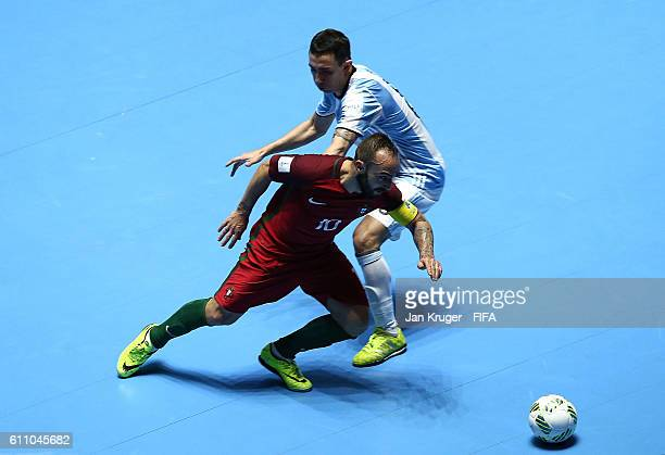 Ricardinho of Portugal is challenged by Santiago Basile of Argentina during the FIFA Futsal World Cup semifinal match between Argentina and Portugal...