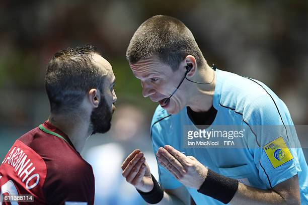 Ricardinho of Portugal is spoken to by a match official during the FIFA Futsal World Cup Semi Final match between Argentina and Portugal at the...