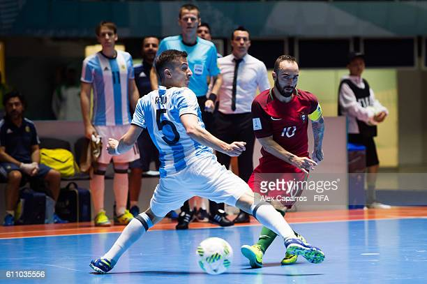 Ricardinho of Portugal plays the ball past Maximiliano Rescia of Argentina during the FIFA Futsal World Cup SemiFinal match between Argentina and...