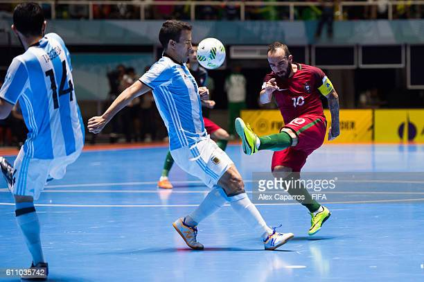 Ricardinho of Portugal shoots the ball and hits Fernando Wilhelm of Argentina during the FIFA Futsal World Cup SemiFinal match between Argentina and...