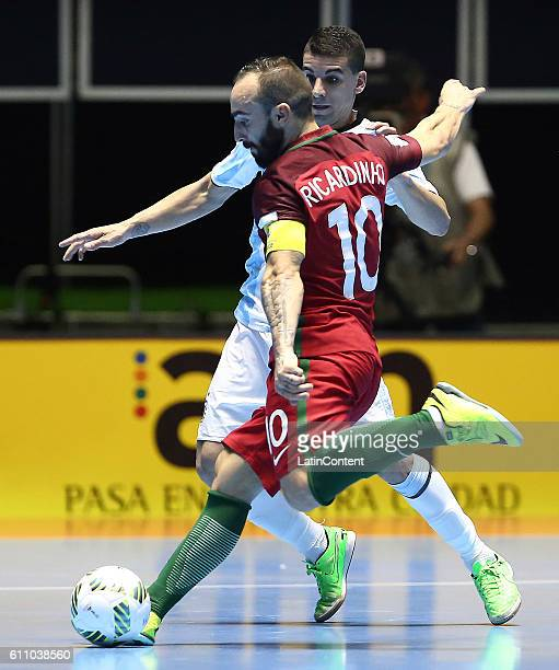 Ricardinho of Portugal takes a shot as Cristian Borruto of Argentina defends during a semi final match between Argentina and Portugal as part of 2016...