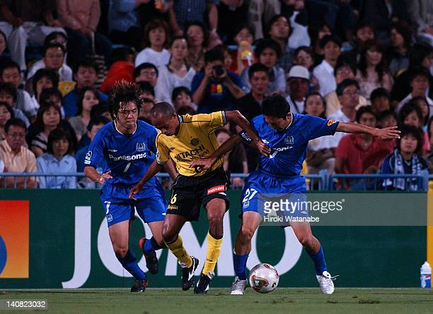 Ricardinho whose real name is Ricardo Alexandre dos Santos of Kashiwa Reysol competes for the ball against Yasuhito Endo and Hideo Hashimoto of Gamba...