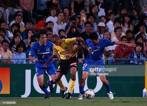 Ricardinho whose real name is Ricardo Alexandre dos Santos of Kashiwa Reysol competes for the ball against Yasuhito Endo and Hideo Hashimoto of Gamba...