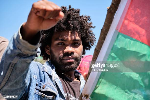 Ricardo a young sympathizer of the independence movement from the RiviereSalee district raises his fist as he takes part in a symbolic day marking...
