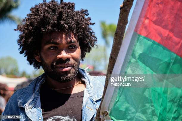 Ricardo a young sympathizer of the independence movement from the RiviereSalee district holds a flag as he takes part in a symbolic day marking the...