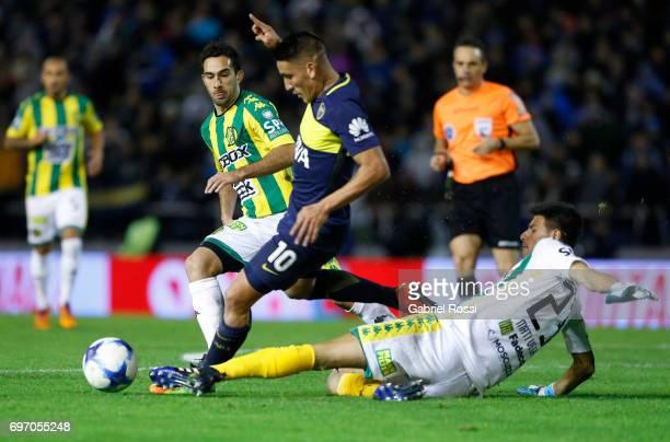 Ricardo Adrian Centurion of Boca Juniors fights for the ball with Matias Vega of Aldosivi during a match between Aldosivi and Boca Juniors as part of...