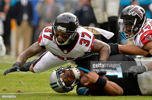 Ricardo Allen and teammate Vic Beasley of the Atlanta Falcons tackle Cam Newton of the Carolina Panthers in the 1st quarter during the game at Bank...