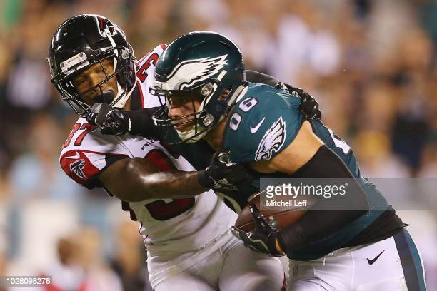 Ricardo Allen of the Atlanta Falcons attempts to tackle Zach Ertz of the Philadelphia Eagles during the second half at Lincoln Financial Field on...
