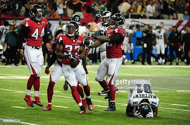 Ricardo Allen of the Atlanta Falcons celebrates after a fourth quarter interception against Jordan Matthews of the Philadelphia Eagles at the Georgia...