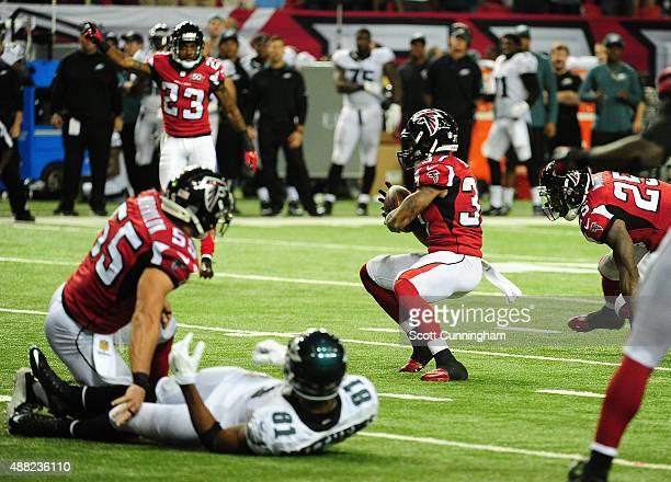 Ricardo Allen of the Atlanta Falcons intercepts a fourth quarter pass against the Philadelphia Eagles at the Georgia Dome on September 14 2015 in...