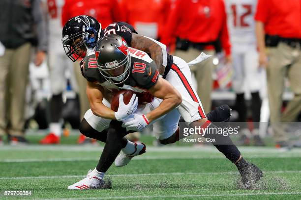 Ricardo Allen of the Atlanta Falcons stops Adam Humphries of the Tampa Bay Buccaneers short of a conversion on fourth down during the second half...