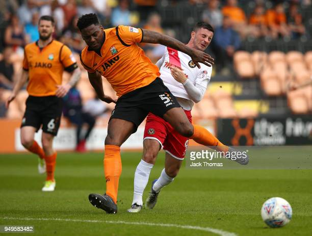 Ricardo Almeida Santos of Barnet FC and Padraig Amond of Newport County AFC compete for the ball during the Sky Bet League Two match between Barnet...