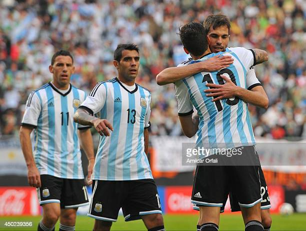 Ricardo Alvarez of Argentina celebrates after scoring the first goal of his team of Argentina during a FIFA friendly match between Argentina and...