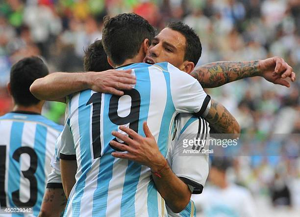 Ricardo Alvarez of Argentina celebrates with teammate Maximiliano Lopez after scoring the first goal of his team of Argentina during a FIFA friendly...