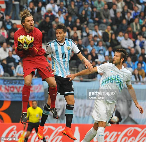 Ricardo Alvarez of Argentina jumps for the ball during a FIFA friendly match between Argentina and Slovenia at Ciudad de La Plata Stadium on June 7...