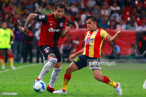 Ricardo Alvarez of Atlas fights for the ball with Aldo Rocha of Morelia during the fifth round match between Atlas and Morelia as part of the Torneo...