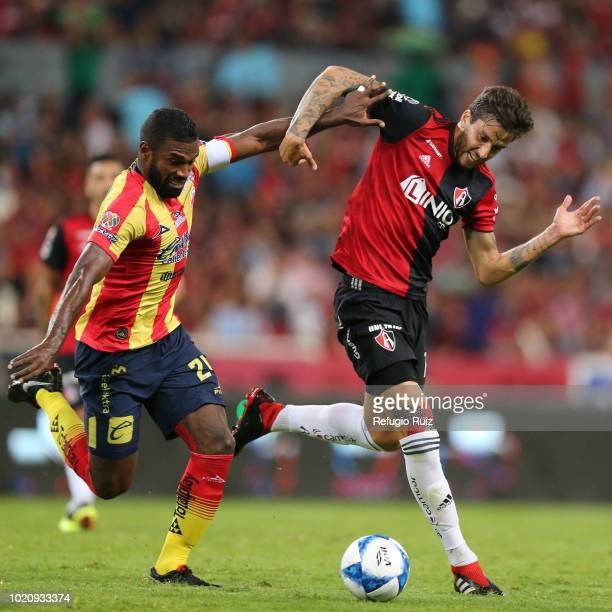 Ricardo Alvarez of Atlas fights for the ball with Gabriel Achilier of Morelia during the fifth round match between Atlas and Morelia as part of the...