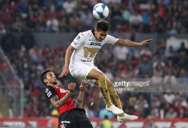 Ricardo Alvarez of Atlas fights for the ball with Rosario Cota of Pumas during their Mexican Apertura 2018 tournament football match at Jalisco...