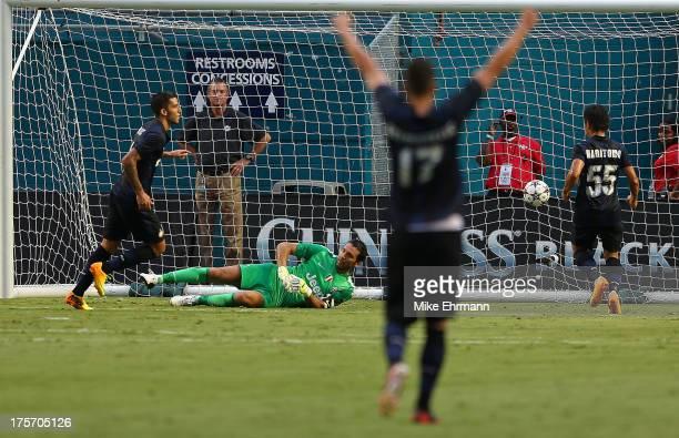 Ricardo Alvarez of Inter Milan scores a goal on Gianluigi Buffon of Juventus during an International Champions Cup Seventh Place Match at Sun Life...