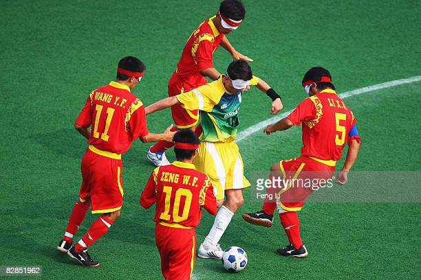 Ricardo Alves of Brazil competes for the ball with China's player in the FiveASide Football match between China and Brazil at Olympic Green Hockey...