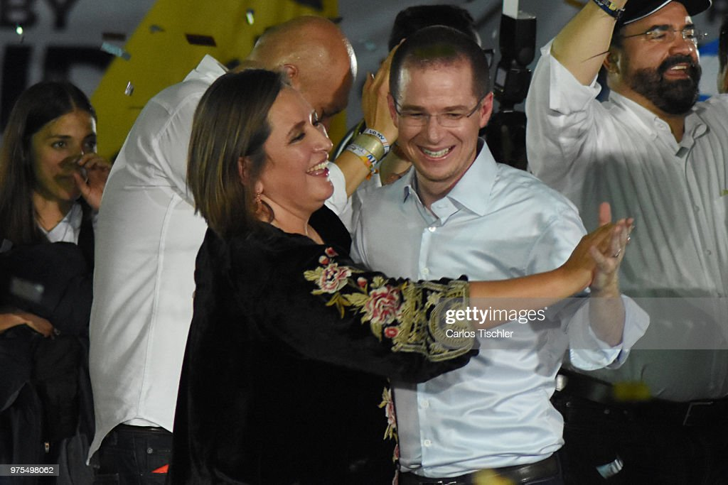 Ricardo Anaya, Presidential candidate for Mexico to the Front Coalition dances with candidate Xochitl Galvez during a Civic Gathering as part of Ricardo Anaya's election campaign at Deportivo Plan Sexenal on June 13, 2018 in Mexico City, Mexico.