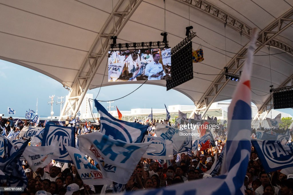 Ricardo Anaya, presidential candidate for the National Action Party (PAN), is seen on a monitor as supporters listen during his final campaign rally in Guanajuato, Mexico, on Wednesday, June 27, 2018. With just four short days before what's likely to be a historic presidential election in Mexico, were about to enter a blackout period. It's the last day for political advertising, campaign events and publishing new polls. Photographer: Mauricio Palos/Bloomberg via Getty Images
