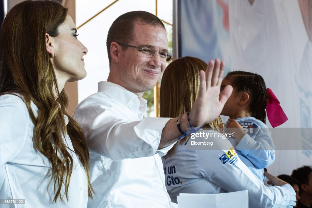 Ricardo Anaya, presidential candidate for the National Action Party (PAN), second left, waves as his wife Carolina Martinez, left, looks on during his final campaign rally in Guanajuato, Mexico, on Wednesday, June 27, 2018. With just four short days before what's likely to be a historic presidential election in Mexico, were about to enter a blackout period. It's the last day for political advertising, campaign events and publishing new polls. Photographer: Mauricio Palos/Bloomberg via Getty Images