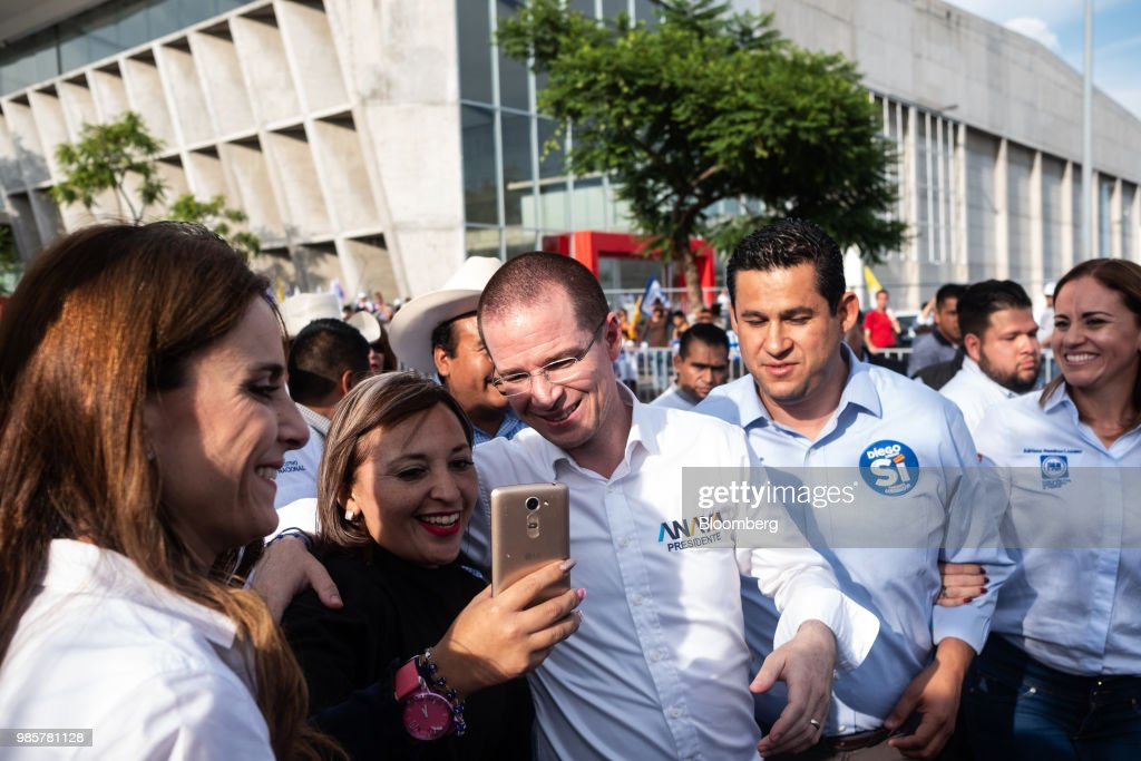 Ricardo Anaya, presidential candidate for the National Action Party (PAN), center, poses for a selfie photograph with a supporter, second left, as he arrives for his final campaign rally in Guanajuato, Mexico, on Wednesday, June 27, 2018. With just four short days before what's likely to be a historic presidential election in Mexico, were about to enter a blackout period. It's the last day for political advertising, campaign events and publishing new polls. Photographer: Mauricio Palos/Bloomberg via Getty Images
