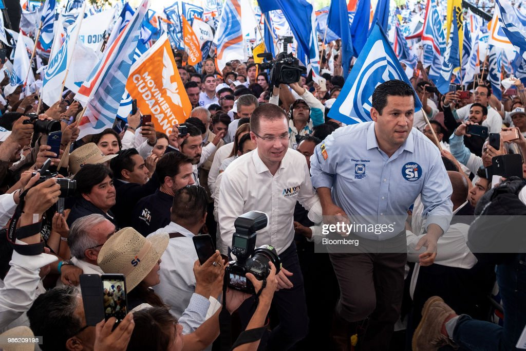 Ricardo Anaya, presidential candidate for the National Action Party (PAN), center, arrives with Diego Sinhue, PAN candidate for governor of Guanajuato, at the final campaign rally in Guanajuato, Mexico, on Wednesday, June 27, 2018. With just four short days before whats likely to be a historic presidential election in Mexico, were about to enter a blackout period. Its the last day for political advertising, campaign events and publishing new polls. Photographer: Mauricio Palos/Bloomberg via Getty Images