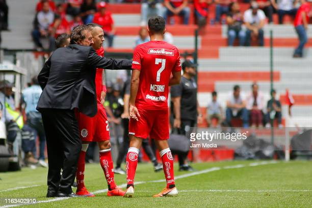 Ricardo Antonio La Volpe Coach of Toluca gives instructions to his players during the 1st round match between Toluca and Queretaro as part of the...