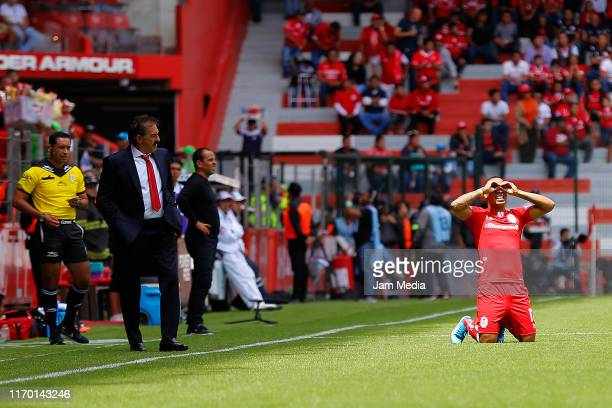 Ricardo Antonio La Volpe coach of Toluca looks on as Felipe Pardo celebrates the first goal of his team after an own goal scored by Diego Braghieri...