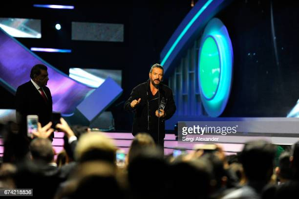 Ricardo Arjona accepts an award onstage at the Billboard Latin Music Awards at Watsco Center on April 27 2017 in Coral Gables Florida