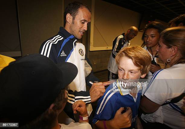 Ricardo Carvalho of Chelsea FC signs a fan's jersey while attending Chelsea FC and InterMilan soccer match benefitting LAFC Chelsea and Africa...