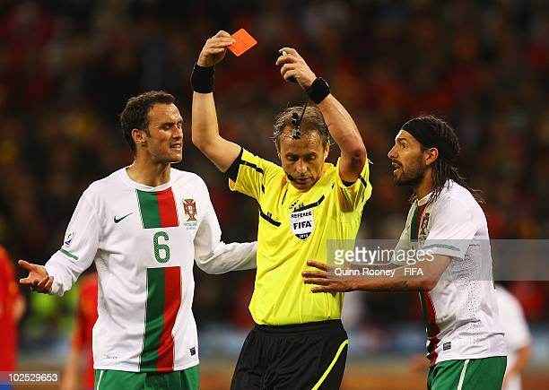 Ricardo Carvalho of Portugal and teammate Danny argue with the referee Hector Baldassi as Ricardo Costa is awarded a red card during the 2010 FIFA...