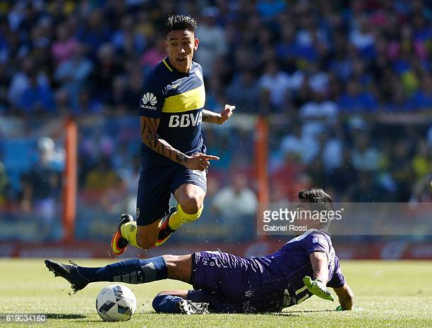Ricardo Centrion of Boca Juniors fights for the ball with Matias Ibañ–ez of Temperley during a match between Boca Juniors and Temperley as part of...