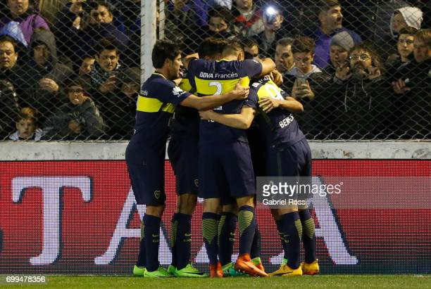 Ricardo Centurion of Boca Juniors celebrates after with teammates scoring the first goal of his team during a match between Olimpo and Boca Juniors...