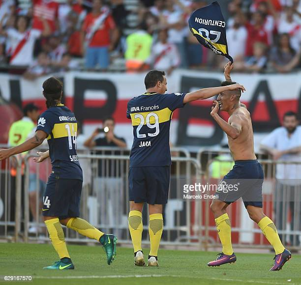 Ricardo Centurion of Boca Juniors celebrates with teammate Leonardo Jara after scoring the fourth goal of his team during a match between River Plate...