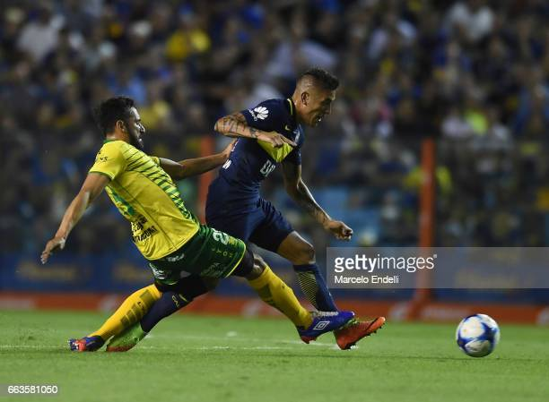 Ricardo Centurion of Boca Juniors drives the ball against Jonas Gutierrez of Defensa y Justicia during a match between Boca Juniors and Defensa y...