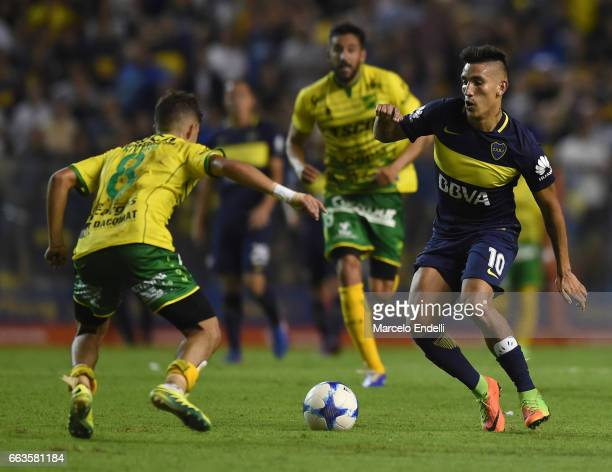 Ricardo Centurion of Boca Juniors drives the ball during a match between Boca Juniors and Defensa y Justicia as part of Torneo Primera Division...