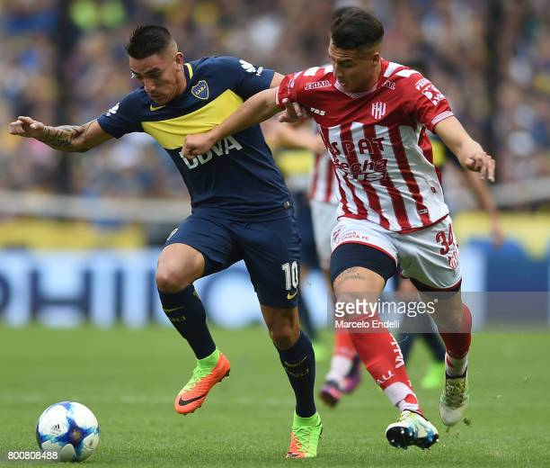Ricardo Centurion of Boca Juniors fights for ball with Brian Blasi of Union during a match between Boca Juniors and Union as part of Torneo Primera...